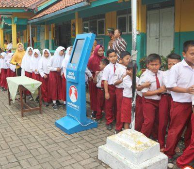 Sebuah Sekolah Dasar Memanfaatkan Kipin ATM